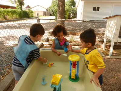 Water exploration and fun happens at the water table.