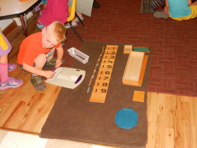 After mastering the 1 to 10 materials, a child learns teen numbers.