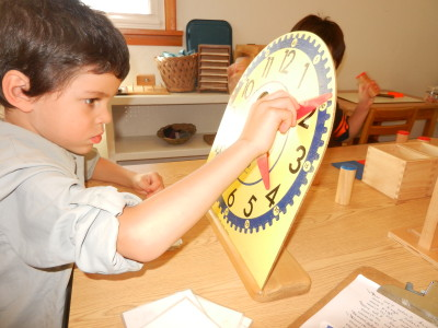 "After a child masters the teen numbers, he is taught how to make the ""o'clocks""."