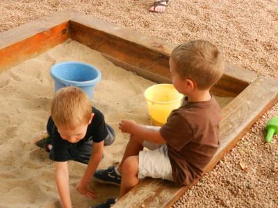 It is fun to play together in the sand box.
