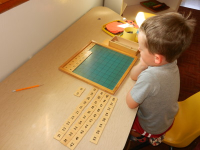 First sorting the number tiles by tens, allows a child to place number 1 to 100.