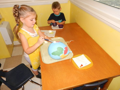 Kindergarteners get to make their own continent and ocean globe.