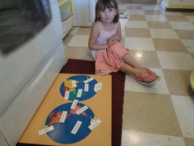 A child labels a map once all of it has been learned.